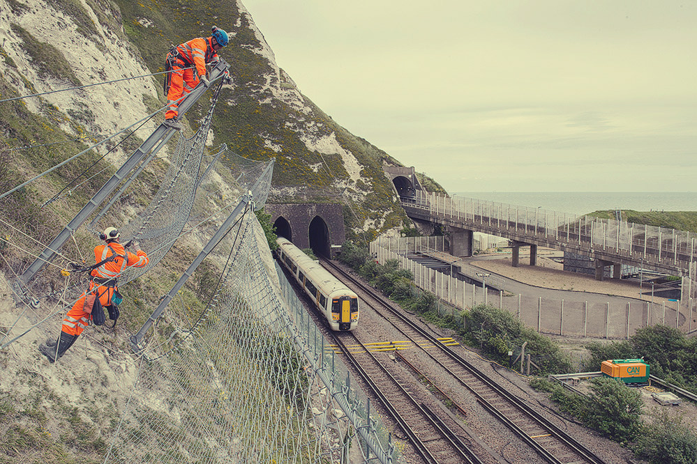 Catch fencing above railway line